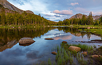 Wind River Range, WY: Calm waters and reflections at dusk from Horseshoe Lake; Lizard Head Meadows area; Bridger Wilderness in the Bridger National Forest in summer