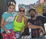 Kaylin, Angela and Jeffery Guthrie during the Hot August Nights Parade in downtown Reno on Sunday, August 13, 2017.
