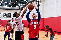HOUSTON, TX - FEBRUARY 1: Danuel House of the Houston Rockets defends Ashlyn Harris #18 of the United States at Houston Rockets Training Center on February 1, 2020 in Houston, Texas.