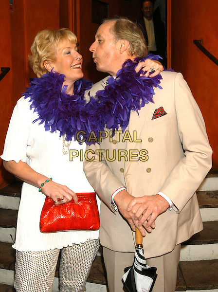 CHRISTINA HAMILTON & NEIL HAMILTON.At charity fashion show in aid of Save the Children Fund .London, 8th July 2002..half length blue feather boa.Ref: PL.www.capitalpictures.com.sales@capitalpictures.com.©Capital Pictures.