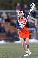 Syracuse University midfielder Tori Praino (26) looks to pass.  Syracuse University (orange) defeated Boston College (white), 17-12, on the Newton Campus Lacrosse Field at Boston College, on March 27, 2013.