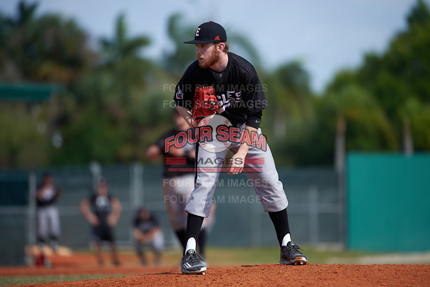 Edgewood Eagles pitcher Ryan Howell (23) looks in for the sign during the first game of a doubleheader against the Lasell Lasers on April 14, 2016 at Terry Park in Fort Myers, Florida.  Edgewood defeated Lasell 9-7.  (Mike Janes/Four Seam Images)