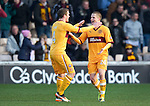 Motherwell v St Johnstone...28.01.12  .Henrik Ojamaa celebrates with Nicky Law.Picture by Graeme Hart..Copyright Perthshire Picture Agency.Tel: 01738 623350  Mobile: 07990 594431
