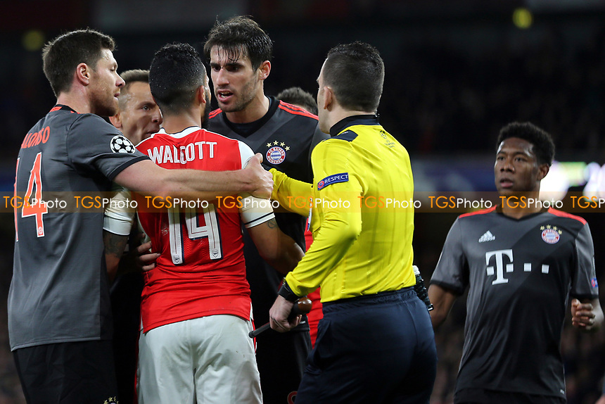 Bayern Munich players in particular, Javi Martinez, were not happy the way Arsenal's Theo Walcott went to ground after a challenge from Xabi Alonso during Arsenal vs FC Bayern Munich, UEFA Champions League Football at the Emirates Stadium on 7th March 2017