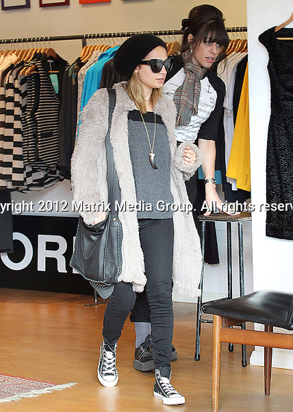 29 May 2012 Sydney, Australia..NON EXCLUSIVE..Nicole Richie spotted shopping at The Factory store at The Intersection - Glenmore Road, Paddington with a male friend.