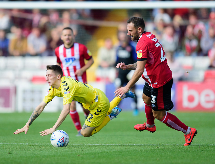 Fleetwood Town's Ashley Hunter is fouled by Lincoln City's Neal Eardley<br /> <br /> Photographer Andrew Vaughan/CameraSport<br /> <br /> The EFL Sky Bet League One - Lincoln City v Fleetwood Town - Saturday 31st August 2019 - Sincil Bank - Lincoln<br /> <br /> World Copyright © 2019 CameraSport. All rights reserved. 43 Linden Ave. Countesthorpe. Leicester. England. LE8 5PG - Tel: +44 (0) 116 277 4147 - admin@camerasport.com - www.camerasport.com