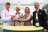 Connections of Fleur Forsyte and jockey Daniel Muscutt receive their trophies during Afternoon Racing at Salisbury Racecourse on 18th May 2017