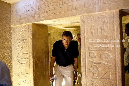 Cairo, Egypt - June 4, 2009 -- United States President Barack Obama ducks his head to get through an entranceway on a tour of the Pyramids and Sphinx in Egypt, Thursday, June 4, 2009.  At center-right is the hieroglyphic that the President comment on saying it looked like him. .Mandatory Credit: Pete Souza - White House via CNP