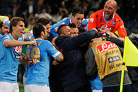Napoli' players celebrates after scoring  during the the Italian Cup final soccer match against d  Fiorentina at the Olympic stadium in Rome May 3, 2014