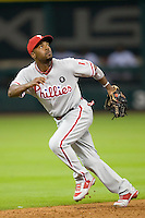 Philadelphia Phillies shortstop Jimmy Rollins #11 tracks a pop up during the Major League Baseball game against the Houston Astros at Minute Maid Park in Houston, Texas on September 12, 2011. Houston defeated Philadelphia 5-1.  (Andrew Woolley/Four Seam Images)