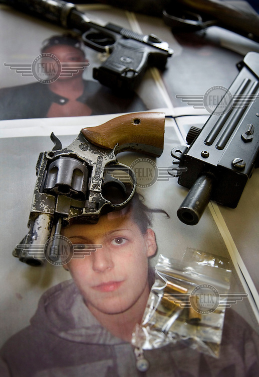 As part of a campaign to warn women not to hide guns for men, Trident, the Metropolitan Police's unit that deals with gun related murders within London's black communities, put on show case studies of women and the weapons they were caught in possesion of. Picture shows Dion Douglas (top) and Jodie Cousins.