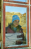 SWEDEN, Swedish Lapland, Woman with a Fake Moustache Through A Glass Door