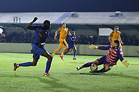 Kojo Awotwi of Maldon is denied by Nick Townsend of Newport County during Maldon & Tiptree vs Newport County, Emirates FA Cup Football at the Wallace Binder Ground on 29th November 2019