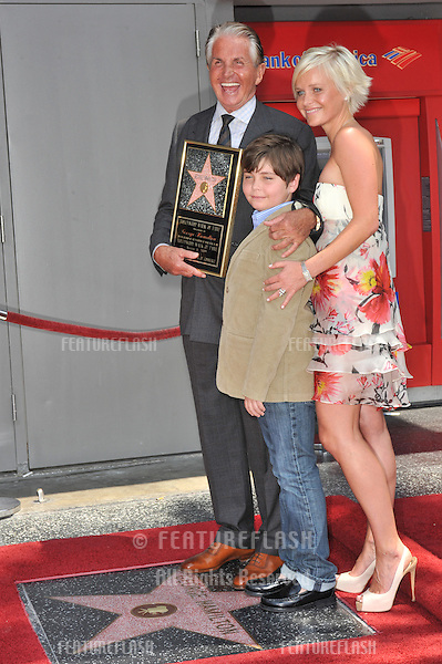 "Actor George Hamilton & son George-Thomas (GT), age 9, & girlfriend Barbara Strum on Hollywood Blvd where he was today honored with the 2,388th star on the Hollywood Walk of Fame. Today was also his 70th birthday and the fans all sang ""Happy Birthday"" to him..He is executive producer of the movie ""My One and Only,"" which is loosely based on his early life with his mother and brothers, which opens next week..August 12, 2009  Los Angeles, CA.Picture: Paul Smith / Featureflash"
