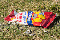 An opened bag of David's Sunflower Seeds lies on the grass at L.P. Frans Stadium in Hickory, NC, Wednesday, May 21, 2008.