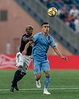 FOXBOROUGH, MA - SEPTEMBER 29: Jesus Medina #19 of New York City FC attempts to control the ball as Luis Caicedo #27 of New England Revolution defends during a game between New York City FC and New England Revolution at Gillette Stadium on September 29, 2019 in Foxborough, Massachusetts.