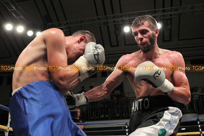 Anthony Cacace (black shorts) defeats Aivaras Balsys in a Super-Featherweight boxing contest at York Hall, Bethnal Green, London, promoted by Queensberry Promotions - 07/09/12 - MANDATORY CREDIT: Gavin Ellis/TGSPHOTO - Self billing applies where appropriate - 0845 094 6026 - contact@tgsphoto.co.uk - NO UNPAID USE.