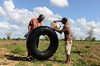 ZAMBIA, Mazabuka, Chikankata area, farm of medium scale farmer Stephen Chinyama, patching a flat tube of a tractor  tire at the field