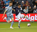 Andreu Fontas (L) of Sporting KC vies for the ball with Rogelio Funes Mori of C.F Monterrey during their CONCACAF Champions League semifinal soccer game on April 11, 2019 at Children's Mercy Park in Kansas City, Kansas.  Photo by TIM VIZER/AFP
