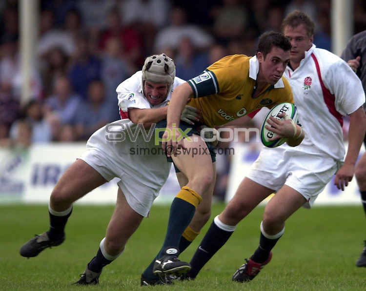 Pix: Matthew Lewis/SWpix.com. International Rugby Union. U21 Rugby World Cup. Australia v England. 13/06/03...COPYRIGHT PICTURE>>SIMON WILKINSON>>01943 436649>>..Australia's Mark Gerrard breaks through the England defence.