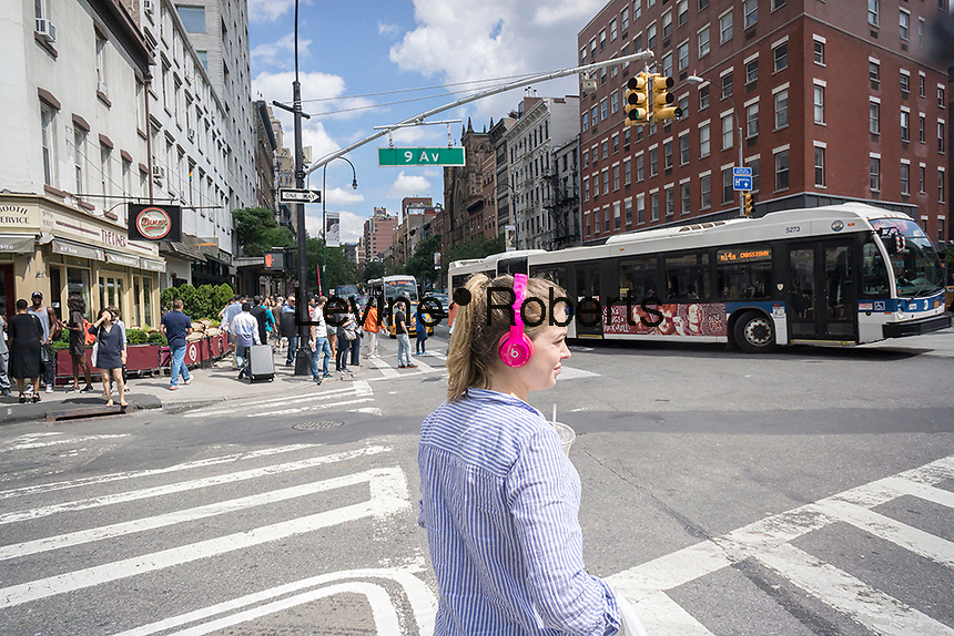 A millennial wearing her Beats by Dr. Dre headphones in New York on Tuesday, July 5, 2016.  (© Richard B. Levine)