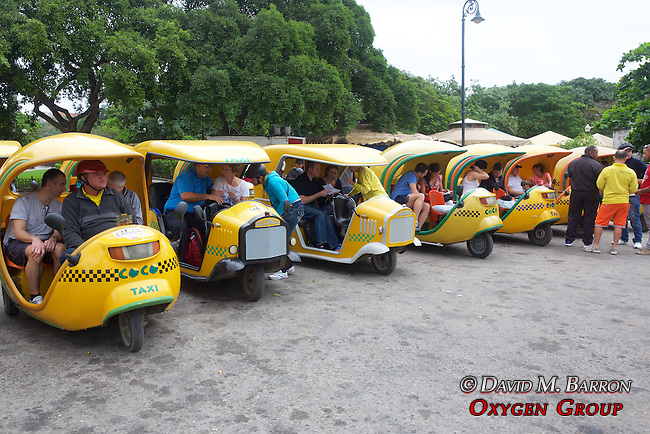 Tourists Taking 3 Wheeled Mini Taxis