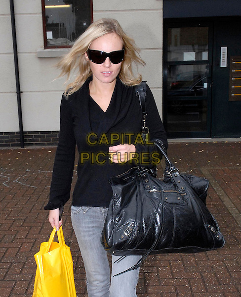 MICHELLE DEWBERRY.Leaving Syed Ahmed's East London home, UK..August 7th, 2006.Ref: DH.half length sunglasses shades bag purse bag jacket.www.capitalpictures.com.sales@capitalpictures.com.©David Hitchens/Capital Pictures.