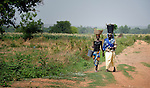 Women walk along a road in Sonougouba, Mali, where the ACT Alliance has worked with local residents to encourage a sustainable economy, increase food security, and improve local governance.