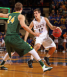 BROOKINGS, SD - JANUARY 25:  Brayden Carlson #12 from South Dakota State University looks to make a move against Taylor Braun #24 from North Dakota State University in the first half of their game Saturday afternoon at Frost Arena in Brookings. (Photo by Dave Eggen/Inertia)