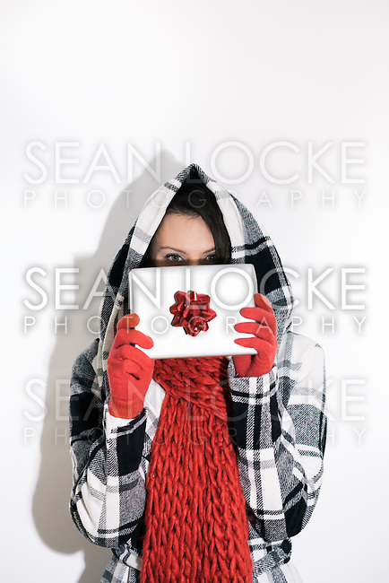 Woman in a hoodie in low and high key images for winter or Christmas.