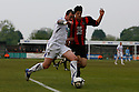 Danny Kedwell of Wimbledon battles with Zac Mills of Histon during the Blue Square Bet Premier match between Histon and AFC Wimbledon at the Glass World Stadium, Histon on 16th April, 2011.© Kevin Coleman 2011.
