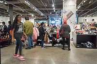 Last minute shoppers in the PacSun stores in the Queens Center Mall in the borough of Queens in New York on Christmas Eve, Saturday, December 24, 2016. A study reports that the holiday shopping season, November and December, now accounts for less than 21 percent of physical stores' sales, down from its peak of 25 percent. (© Richard B. Levine)