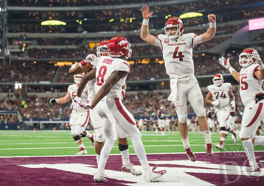 Hawgs Illustrated/Ben Goff<br /> Arkansas players, including quarterback Ty Storey (4) and wide receiver Mike Woods (8) celebrate after a touchdown pass to Woods in the 4th quarter vs Texas A&M Saturday, Sept. 29, 2018, during the Southwest Classic at AT&T Stadium in Arlington, Texas.