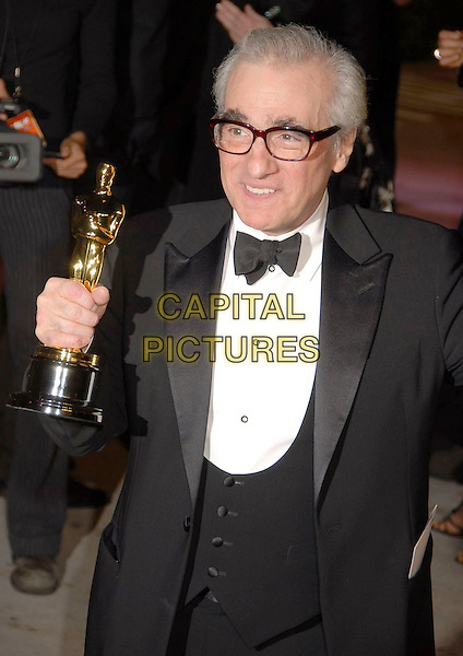 MARTIN SCORSESE.The 2007 Vanity Fair Oscar Party Hosted by Graydon Carter held at Morton's, West Hollywood, California, USA, 25 February 2007..oscars half length holding trophy winner.CAP/ADM/GB.©Gary Boas/AdMedia/Capital Pictures.