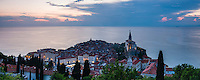 Panoramic photo of Piran, Slovenia at sunset, and the Mediterranean Sea, seen from Piran Town Walls, Slovenian Istria, Slovenia, Europe