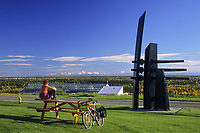 Student at the University of Alaska Fairbanks, enjoys views of the Alaska Range from the museum lawn.