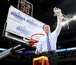 SIOUX FALLS, SD - MARCH 8:  Head Coach Aaron Johnston from South Dakota State University raises the net following their 61-55 win over the University of South Dakota in the 2016 Summit League Championship Game Tuesday afternoon in Sioux Falls. (Photo by Dave Eggen/Inertia)