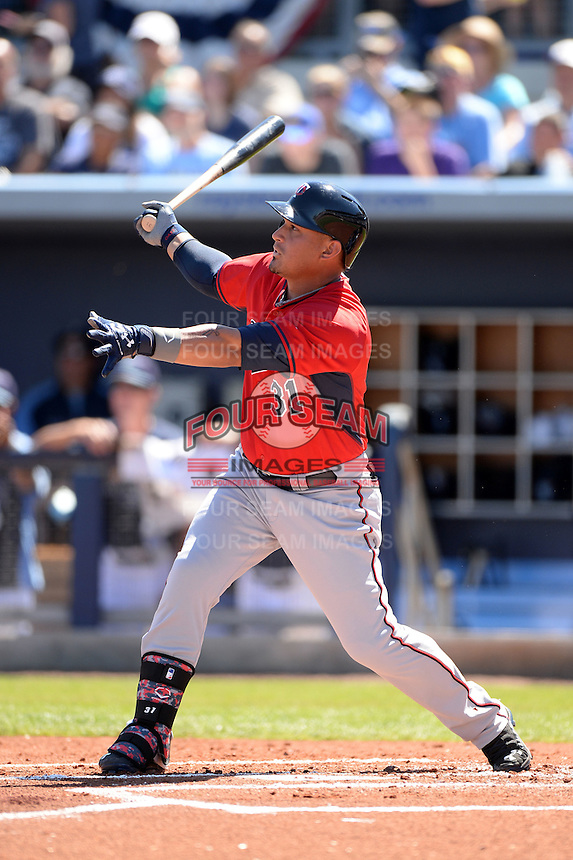 Outfielder Oswaldo Arcia (31) of the Minnesota Twins during a spring training game against the Tampa Bay Rays on March 2, 2014 at Charlotte Sports Park in Port Charlotte, Florida.  Tampa Bay defeated Minnesota 6-3.  (Mike Janes/Four Seam Images)