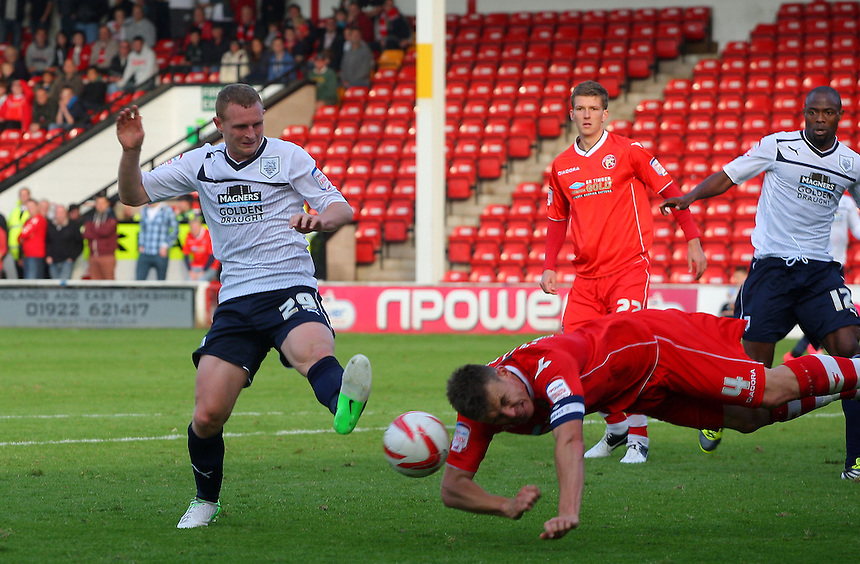 Preston North End's Stuart Beavon in action with Walsall's Andy Butlet..Football - npower Football League Division One - Walsall v Preston North End - Saturday 22nd September 2012 - Banks's Stadium - Walsall..
