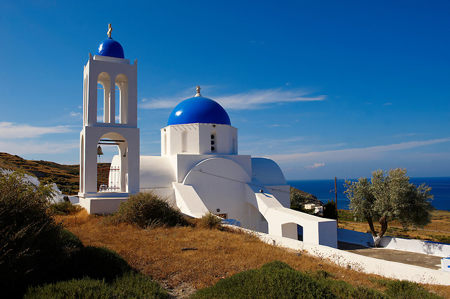 Blue domed Greek Orthodox church and bell tower near oia (Ia), Santorini, Greece
