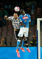 Juventus' Simone Zaza jump for the ball with Napoli's Kalidou Koulibaly  during the  italian serie a soccer match,    at  the San  Paolo   stadium in Naples  Italy , September 26 , 2015