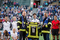 Seattle, Washington -  Sunday, September 11 2016: Seattle Reign FC midfielder Keelin Winters (11) is greeted by the Kirkland Fire Department before a regular season National Women's Soccer League (NWSL) match between the Seattle Reign FC and the Washington Spirit at Memorial Stadium. Keelin has announced her retirement from soccer and will move to a new career as a firefighter.