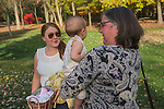 Nicole and Calder Preyer with their daughter Sydney at the Tanger Family Bicentennial Garden on Thursday, November 13, 2014. (Photo by Artisan Image, Inc.)