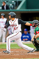 Santiago Nessy (37) of the Lansing Lugnuts follows through on his swing against the Fort Wayne TinCaps at Cooley Law School Stadium on June 5, 2013 in Lansing, Michigan.  The TinCaps defeated the Lugnuts 8-5.  (Brian Westerholt/Four Seam Images)