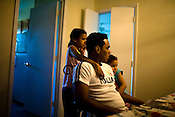 May 21, 2009. Raleigh, NC..Photographs of Cuban immigrants to North Carolina..Camilche Casamayor, with his daughters (l to r) Walhlis Casamayor, 8, and Zucel Casamayor, 5.