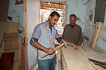HURGHADA - EGYPT - 03 March 2015 -- Essam working in carpenter workshop and the owner Ahmed is watching him. -- Photo: Kimmo HAGMAN / EUP-IMAGES