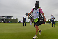 Tony Romo's (a) (USA) caddie braves the cold on his way to the tee on 13 during round 2 of the AT&T Byron Nelson, Trinity Forest Golf Club, Dallas, Texas, USA. 5/10/2019.<br /> Picture: Golffile | Ken Murray<br /> <br /> <br /> All photo usage must carry mandatory copyright credit (© Golffile | Ken Murray)