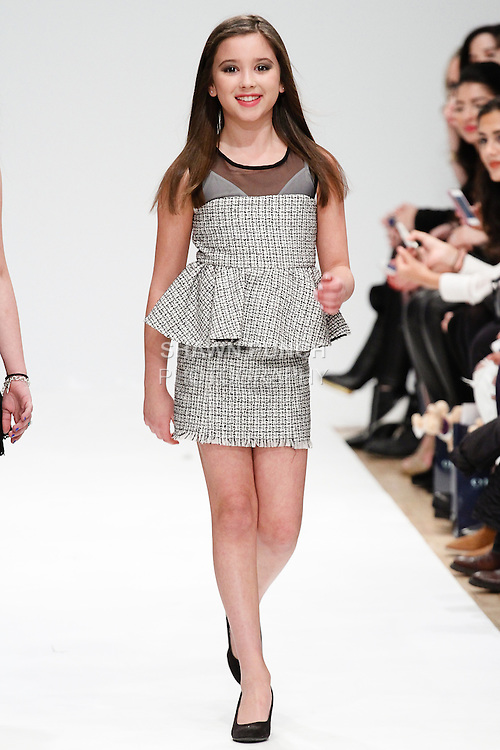 Model walks runway in an outfit from the Isabella Barrett Collection by Chance R Designs and Toni Lyn Spaziano, during the Bound by the Crown Couture fashion show at Fashion Gallery Fashion Week NY Fall 2014, February 8, 2014.