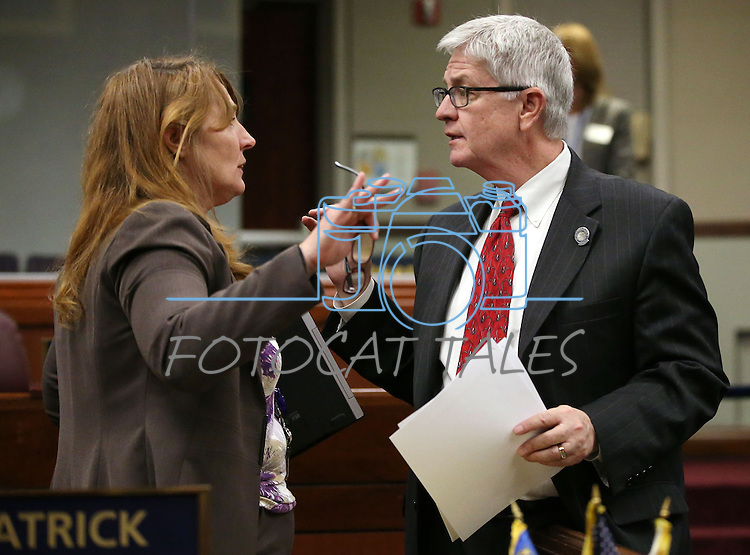 Nevada Assembly Minority Leader Marilyn Kirkpatrick, D-North Las Vegas, talks with Assemblyman Erven Nelson, R-Las Vegas, talk on the Assembly floor at the Legislative Building in Carson City, Nev., on Wednesday, May 13, 2015. <br /> Photo by Cathleen Allison