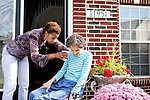 "Karen Morris has been caring for her mother Gloria, 80, for the past 10 years. Her mother has Alzheimer's disease and lives with Karen and Karen's husband Richard in their Charlotte, NC home. She tries to have her mother drink some coffee on the front porch...Mrs. Morris was a nurse before she retired and really enjoys taking care of people, she said. Every morning she washes her mother in the bathroom, helps her walk down the stairs, and they share breakfast, as they did Monday, October 18, 2010...Gloria was having an especially bad day and because Karen sees her every day, she knew something was wrong. She later discovered her medication was dehydrating her. That is one of many reasons why having a regular caretaker is so important. ..Released: Yes.""Caretaker"".Assignment c/o Ilene Bellovin"